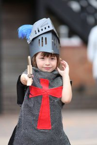 A young boy dressed up as a Knight