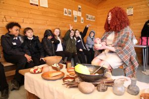 Our Boudicca teaching pupils about Iron Age life